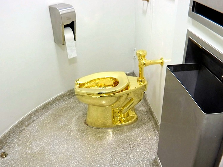FILE - This Sept. 16, 2016 file image made from a video shows the 18-karat toilet, titled