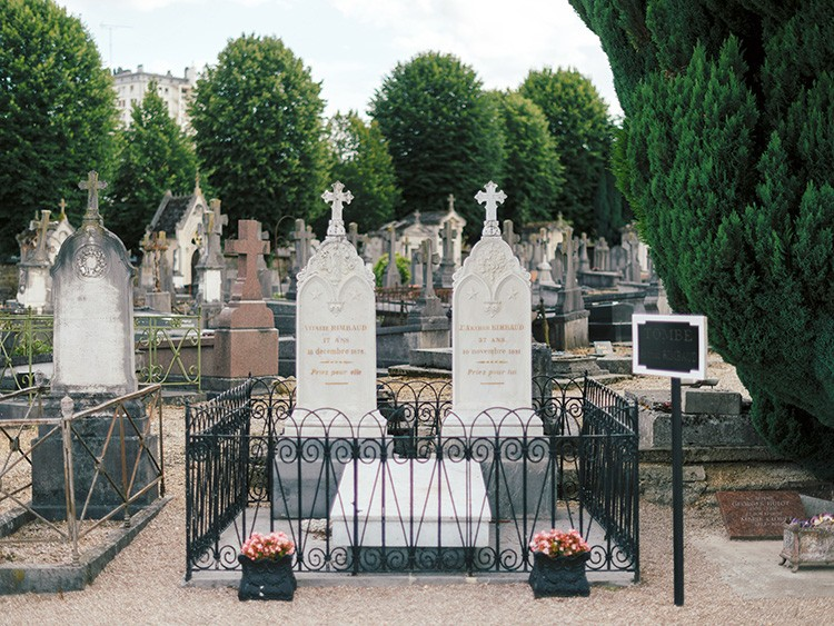 "**EMBARGO: No electronic distribution, Web posting or street sales before MONDAY 2:45 a.m. ET SEPT. 16, 2019. No exceptions for any reasons. EMBARGO set by source.** The grave of the poet Arthur Rimbaud, who died in 1891, in Charleville-Mézières, France, Aug. 8, 2019. Pilgrims now flock to the long-ignored grave of Rimbaud, the ""Jim Morrison of poets,"