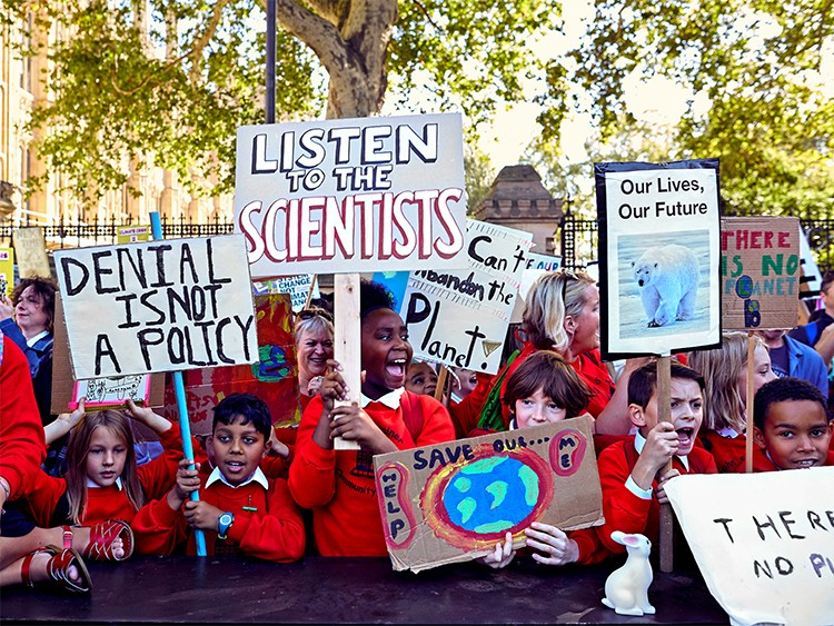 LONDON — BC-OPED-MARGOLIN-CLIMATE-STRIKE-ART-NYTSF — Children at the Climate Strike outside parliament in central London, on Friday. (CREDIT: Olivia Harris/The New York Times)--ONLY FOR USE WITH ARTICLE SLUGGED -- BC-OPED-MARGOLIN-CLIMATE-STRIKE-ART-NYTSF -- OTHER USE PROHIBITED.
