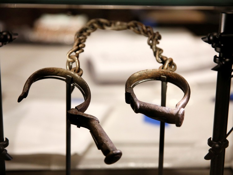 Slave shackles are seen in a display case during a media preview at the National Museum of African American History and Culture on the National Mall in Washington September 14, 2016. The museum will open to the public on September 24. REUTERS/Kevin Lamarque