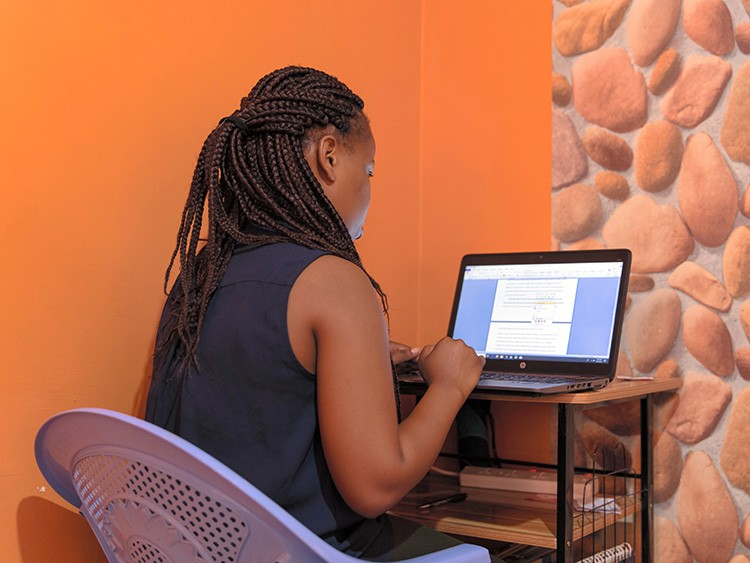 Mary Mbugua works on a paper for a client, from her home in Ruiru, Kenya, Aug. 30, 2019. Amid the college admissions scandal, another type of cheating was overlooked: Students already in college who pay others to write their papers. (Sarah Waiswa/The New York Times)
