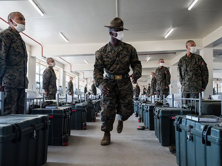 Sgt. Kirk Broxton checks to see how well beds are made in a barracks at the Marine Corps Recruit Depot in San Diego on Oct. 8, 2020. Even in the pandemic, recruits are expected to pay attention to painstaking detail. (Ariana Drehsler/The New York Times)