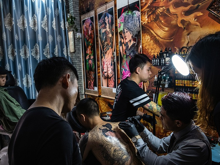 FILE -- A tattoo studio in Shenzhen, China, on Oct. 24, 2018. Many younger Chinese have embraced tattooing, but others associate it with criminality. (Lam Yik Fei/The New York Times)