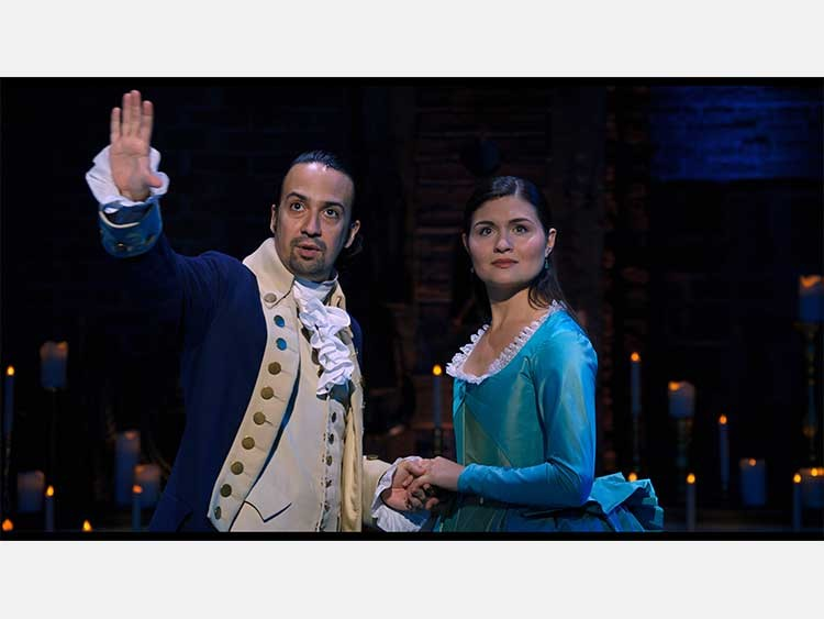 Lin-Manuel Miranda is Alexander Hamilton and Phillipa Soo is Eliza Hamilton in HAMILTON, the filmed version of the original Broadway production.
