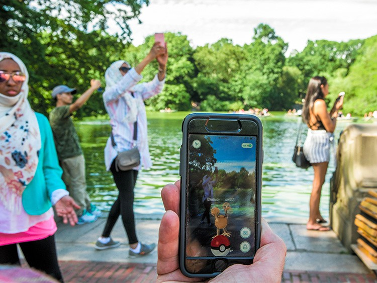 FILE -- A user plays Pokemon Go in New York's Central Park Central Park on July 11, 2016. After the app was available in Canada, the Canadian Armed Forces issued a public warning, urging civilians to avoid military property when searching for Pokémon. (George Etheredge/The New York Times)